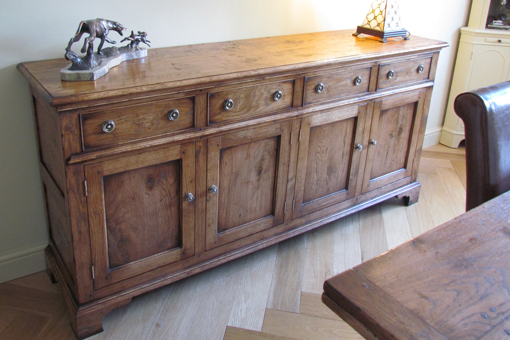 Oak 4 Drawer, 4 Door, Dresser Base with bracket feet finished in Antique Straw